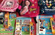 Se distribuie ghiozdanele cu echizitele către școli și grădinițe